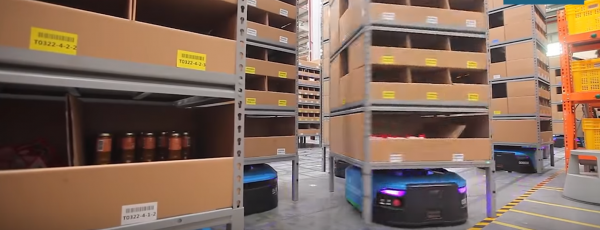 Spinning robots in the Alibaba warehouse. Thanks to them people have less work