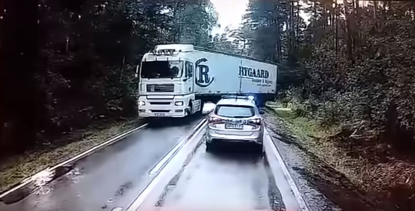 A rushing truck would have almost wiped out a police car. It was like an action movie.