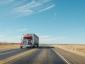Un transportator care își plătea șoferii în funcție de distanța parcursă, forțat să achite compensații de 28 milioane USD