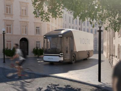 A jövő furgonjai Londonban. Kinézetre olyanok, mint az autóbuszok, de a járművezető a kabin közepén ül