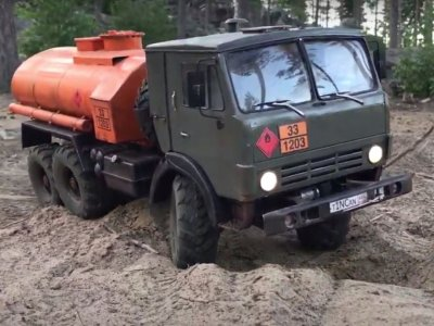 Off-road ride in small replicas of KRAZ and KAMAZ trucks