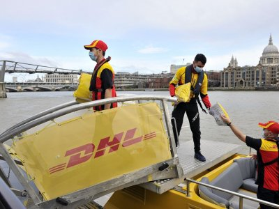 Electric van, riverboat then bike – DHL goes green in London