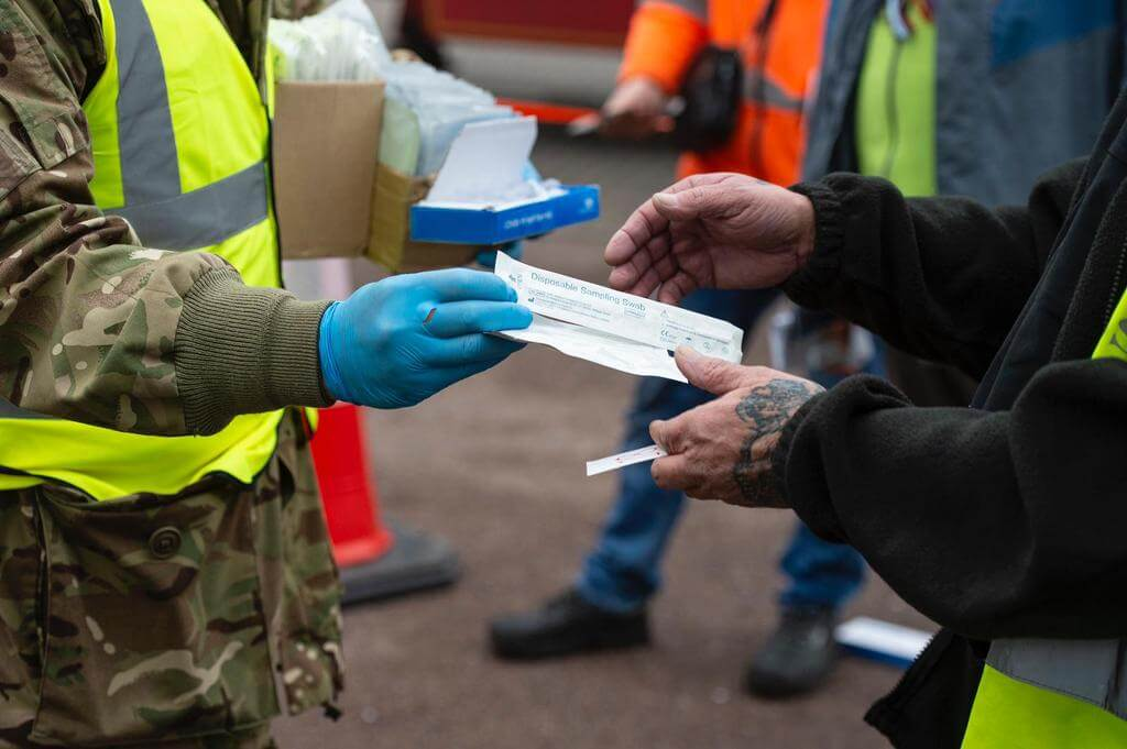 What happens to truckers who test covid-positive in the UK?