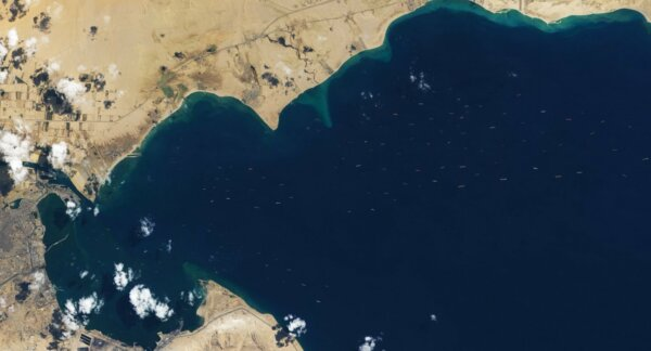 Resolving the ship backlog puzzle in the Suez Canal: predicting ship transits in capacity-constraine