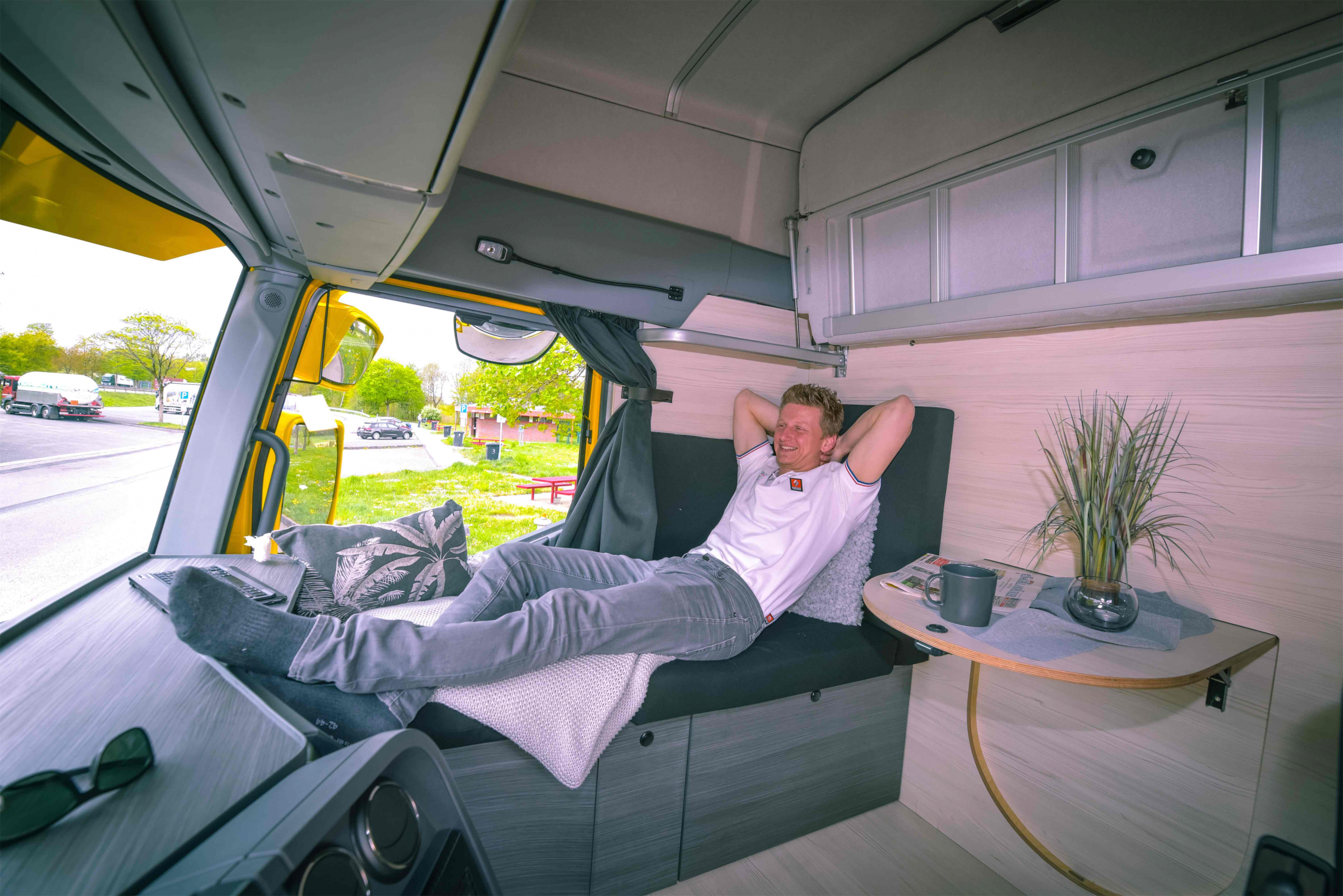 The lorry cabin with a lounge area and washbasin for solo drivers