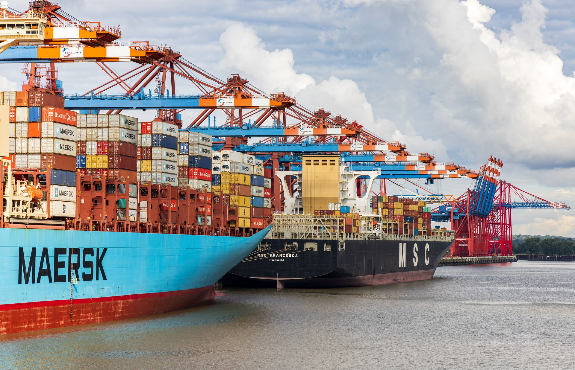 Improving a congested maritime supply chain with time slot management for port calls
