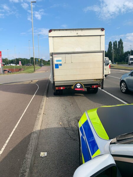 Trucker fined after ignoring red light in an uninsured lorry – right in front of police car