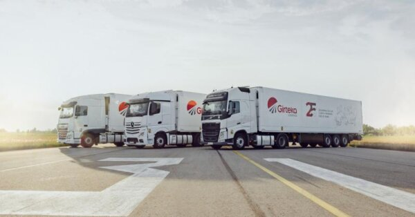 How can the age of a truck influence the efficiency of road freight transport?